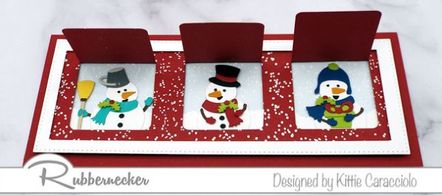 The inside of the windows on a slimline peek a boo Christmas card featuring adorable pieced die cut snowmen in each die cut window
