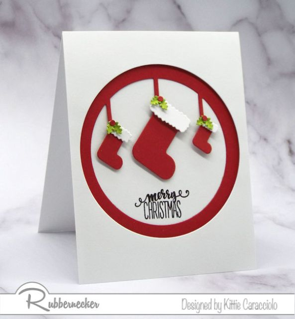 A simple handmade Christmas card made using these framed die cut red stockings really pop against the all-white background.