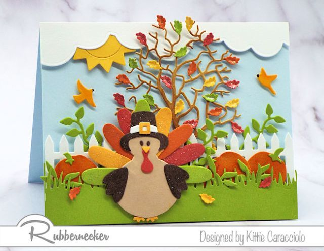 A die cut turkey sporting a pilgrim hat set in a fall scene to create thanksgiving cards to make and send
