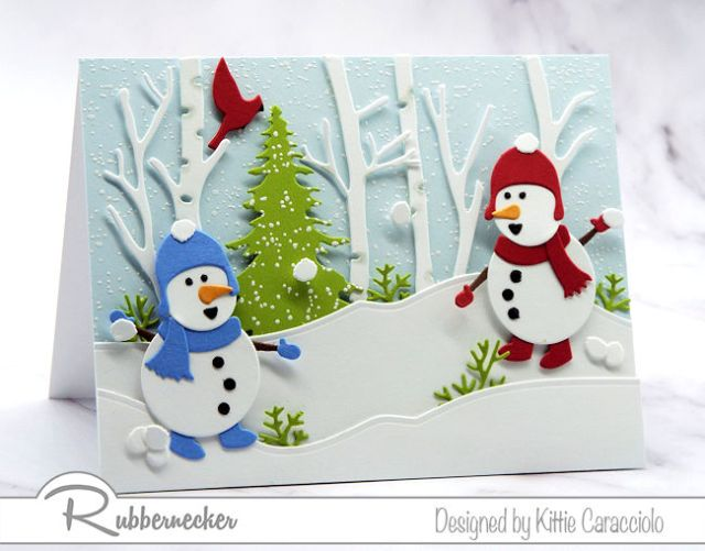 A fresh take on snowman card ideas showing two tiny snowmen having a snowball fight in a wintry scene all made using dies from Rubbernecker