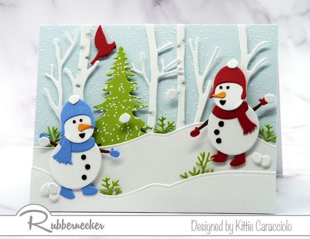 One of my snowman card ideas made using die cuts from Rubbernecker showing two tiny snowmen in their snowy forest