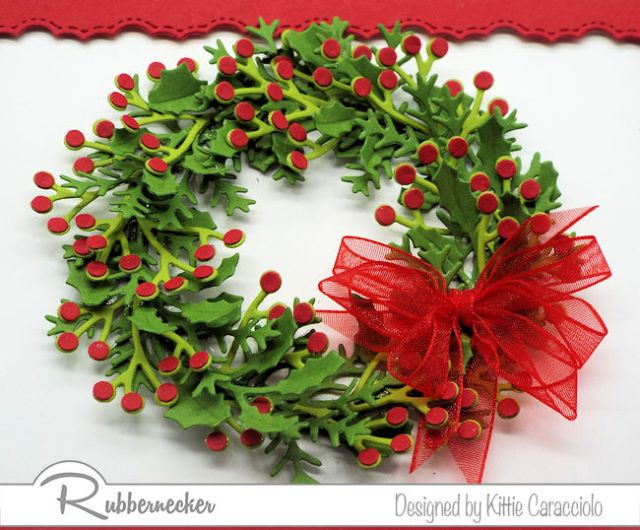 Today's post is about how to make a wreath with die cuts as shown here with many layers of die cut greenery accented with tiny die cut berries all from Rubbernecker