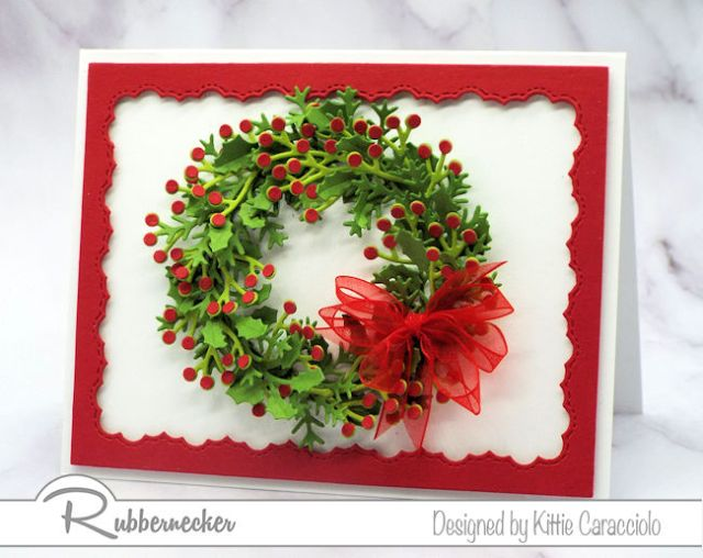 Learn how to make a wreath with die cuts as was done here with many layers of holly and pine all using products from Rubbernecker