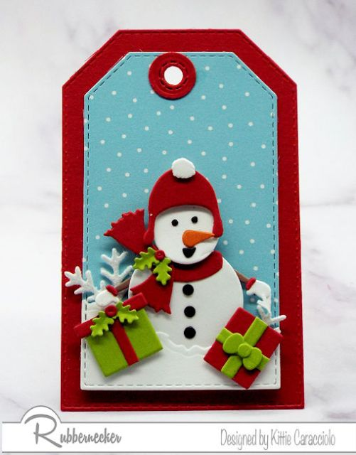 another of today's snowman tags shpwing a little fellow delivering gifts in a snowy scene all thanks to to die cuts from Rubbernecker