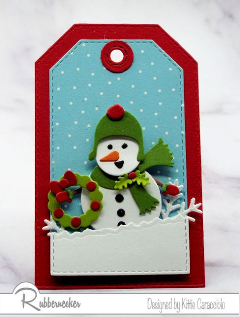 One of three adorable snowman tags showing a snowman warmly clad for a snowy scene all created using die cuts from Rubbernecker