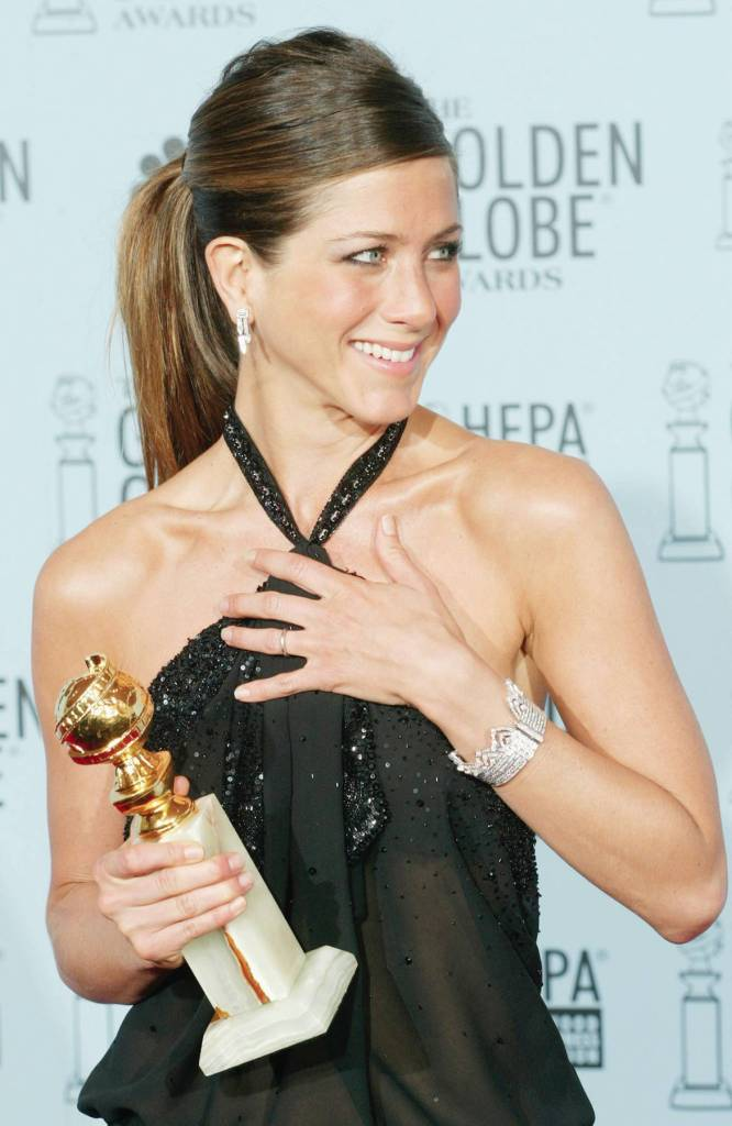 JENNIFER ANISTON HOLDS GOLDEN GLOBE AWARD