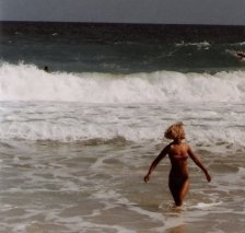 China ~ Rose, body surfing in her Pinup swimsuit design, Waimea, HI, circa 1986