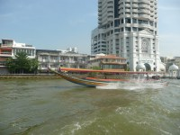 Water taxi jetting down the river on our way into the city