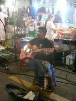 Kid performing Gangam Style on the guitar. We dropped him a few baht, he rocked it.
