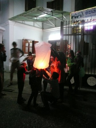 Neighborhood kids lighting a lantern