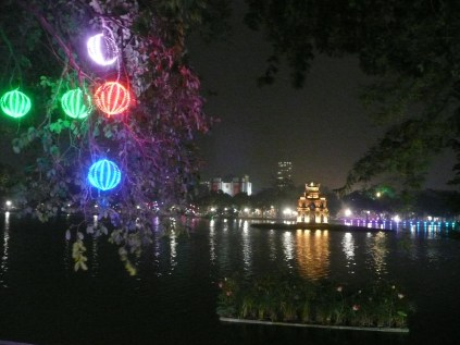 Lanterns along the lake at night