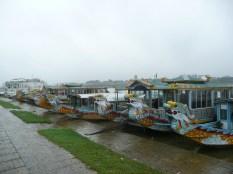 Dragon boats docked at the riverside