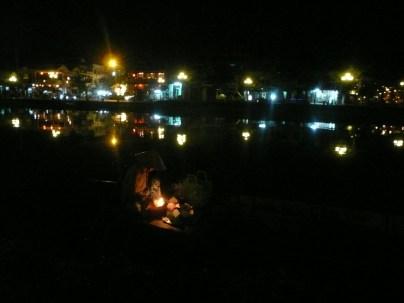 Woman selling lanterns along the river