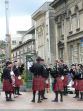 Battle of the bagpipe bands in Downtown Dunedin