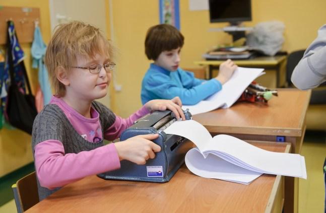 PHOTO: BARTOSZ KRUPA/EAST NEWS OWINSKA, 30/01/2013. OSRODEK OPIEKUNCZO - WYCHOWAWCZY DLA DZIECI NIEWIDOMYCH W MIEJSCOWOSCI OWINSKA. N/Z: LEKCJA RELIGII W SZKOLE PODSTAWOWEJ. DZIECI PISZA WYKOZYSTUJAC MASZYNY BRAILE'A. Owinska, Poland 30/01/2013 The school for blind children in Owinska. In the picture: religion lesson at primary school. Children are writting on Braile typewriters.