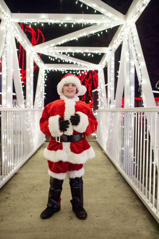 "A young Santa at the Kiwanis Holiday Lights at Sibley Park in Mankato, Minn., on Friday, Nov. 29, 2013. The Kiwanis Holiday Lights feature over one million LED lights decorating trees, fences and buildings in the park. New this year is the Mary Dotson Skating Rink, which will feature synthetic ice, enabling skaters to enjoy the rink regardless of the weather. ""Last year we were thrilled to have over 100,000 visitors. This year we're planning to further expand the event by adding more lights and lighted displays,"" said Scott Wojcik, Kiwanis Holiday Lights President. Photo by Ackerman + Gruber"