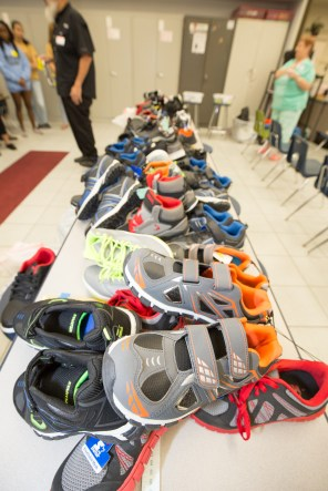 Shoes are organized by size for the arrival of Fairglen Elementary students on in Cocoa, Florida on Thursday, November 10, 2016.