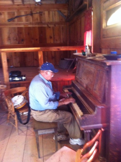 Plays the piano well in the saloon