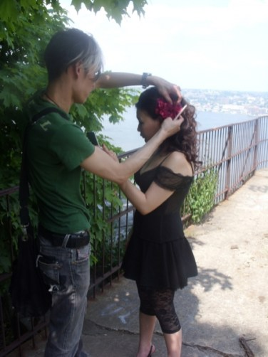 1330661536_fixing-flower-in-hair-for-photoshoot