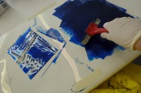 Rolling out the paint for the collograph.