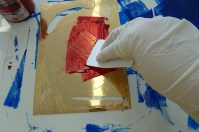 Drypoint etching with oil-based ink being applied with a cardboard squidgy.