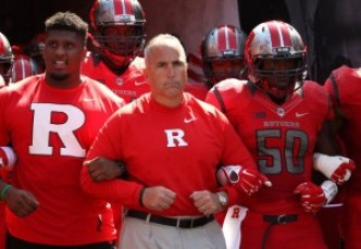 Rutgers head coach Kyle Flood leading his team to the field during their home opener against Norfolk State (John Munson | NJ Advance Media for NJ.com)