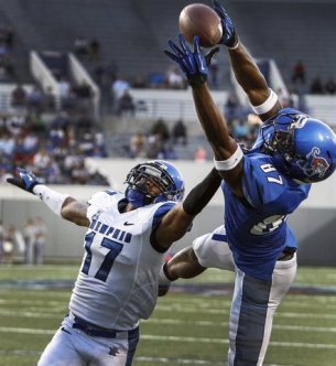 Memphis' Tevin Jones (87) hauls in a pass over teammate Chris Morley (17) during the Blue-Gray game. (Mark Weber/The Commercial Appeal)