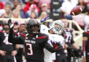 Texas Tech DB J.J. Gaines (3) defends a pass against former KU receiver Nick Harwell (8) (Nick Krug - KUSports)
