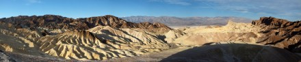 View from Zabriskie Point (early enough in the morning that the shadow of the structure on the viewpoint is visible)