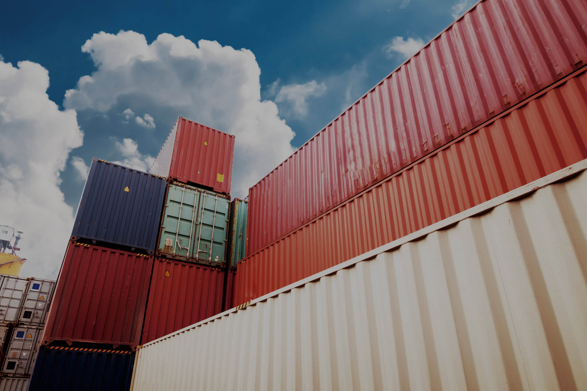 variety of stacked shipping containers for sale