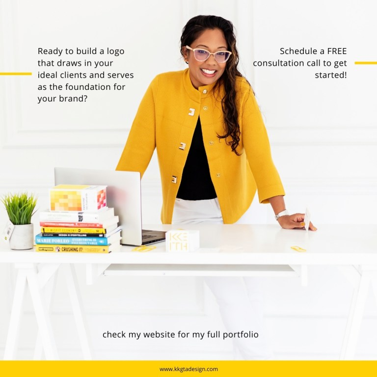 woman with dark hair and a yellow cardigan smiling with hands on a white desk.