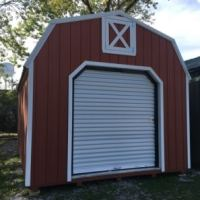 12x16 lofted barn w/ roll-up door, Cape Cod red w/ white trim, white metal roof