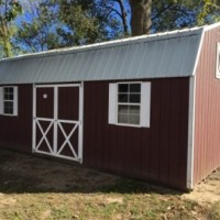 Pre-owned: 12x24 Lofted Barn, DOS, red w/ white trim & white metal roof (work bench and ramp included)