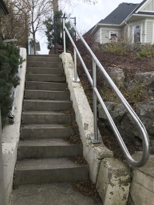 "stainless steel 2"" railing on concrete stairway"