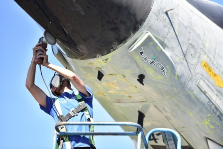 A Ponsford restorer works on grinding paint on the F4 Phantom display jet in preperation for a fresh coat of paint at Kingsely Field Air National Guard Base on July 2, 2019. These jets are on loan from the Museum of the US Air Force, and are getting their first full refresh in 15 years.