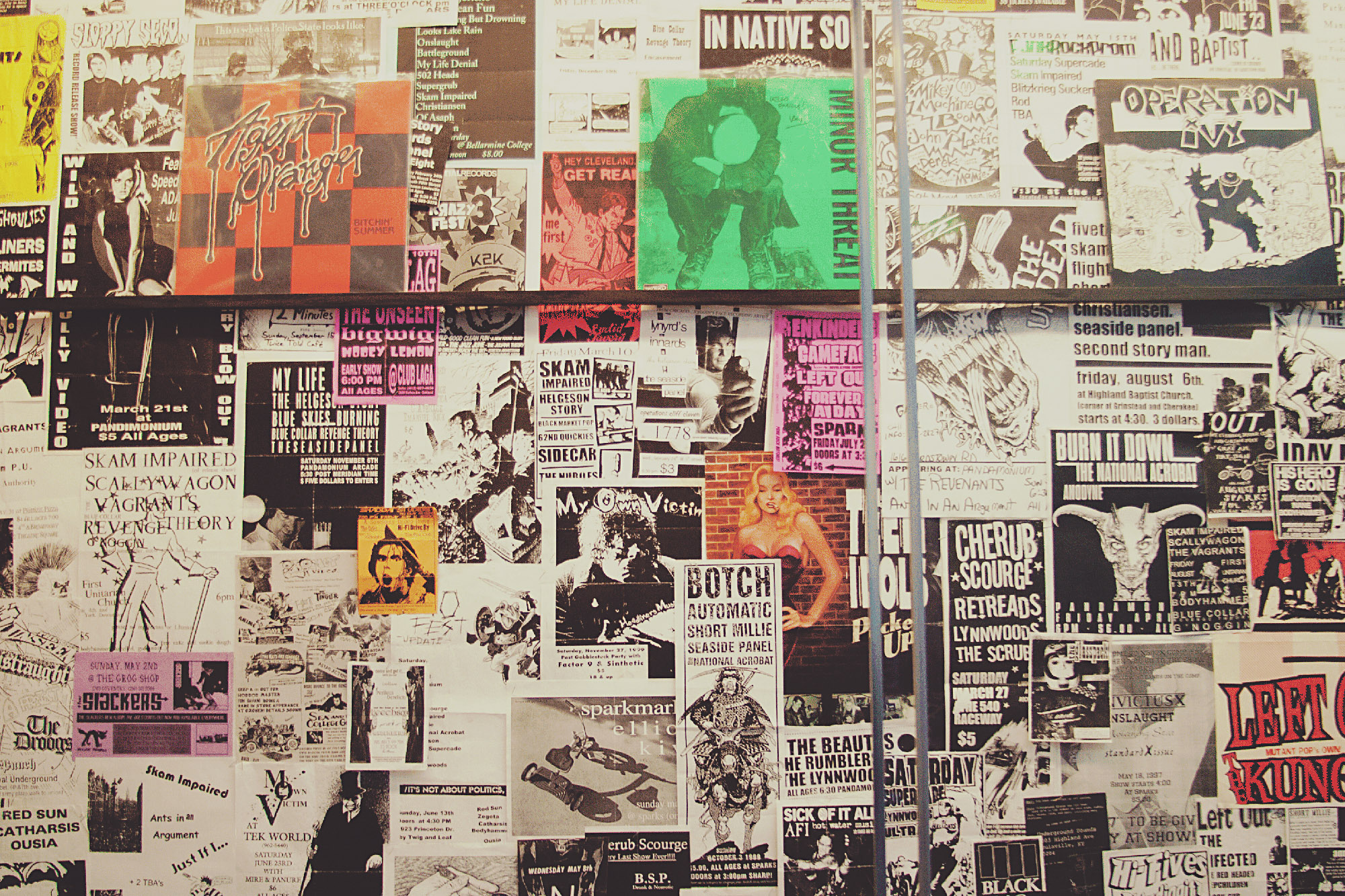 wall of posters and flyers brand awareness
