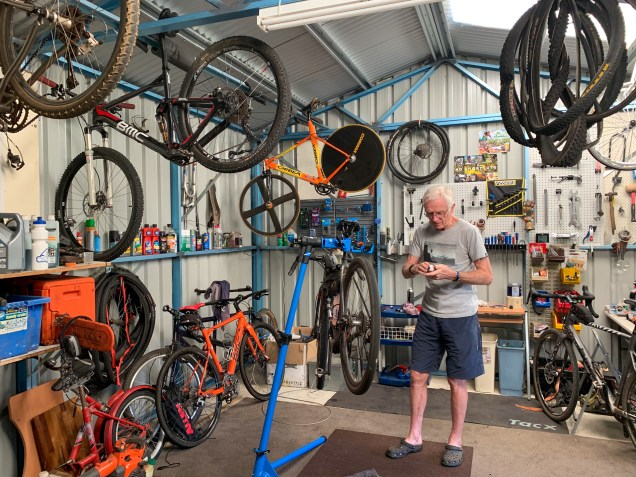 inside John's garage, filled with bicycles