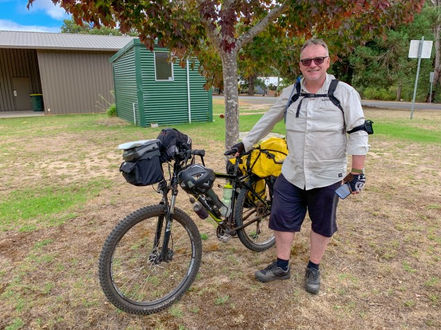 Chris next to his mountain bike