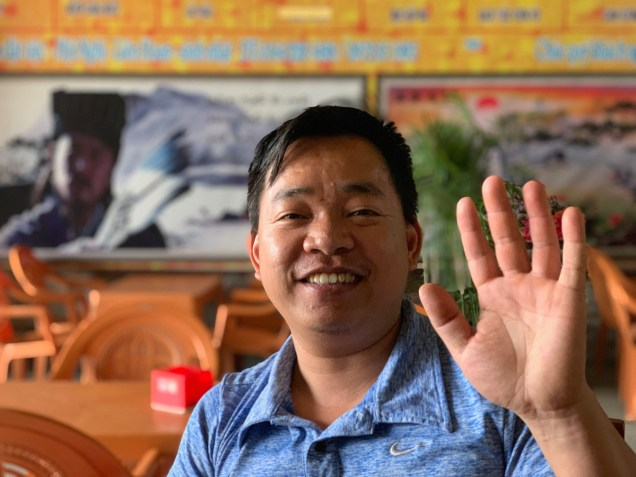 Hung, owner of a roadside restaurant and my first real interaction with a local on the road