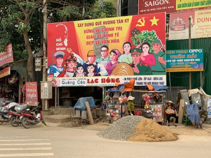 Propaganda billboard in the center of town at a main intersection