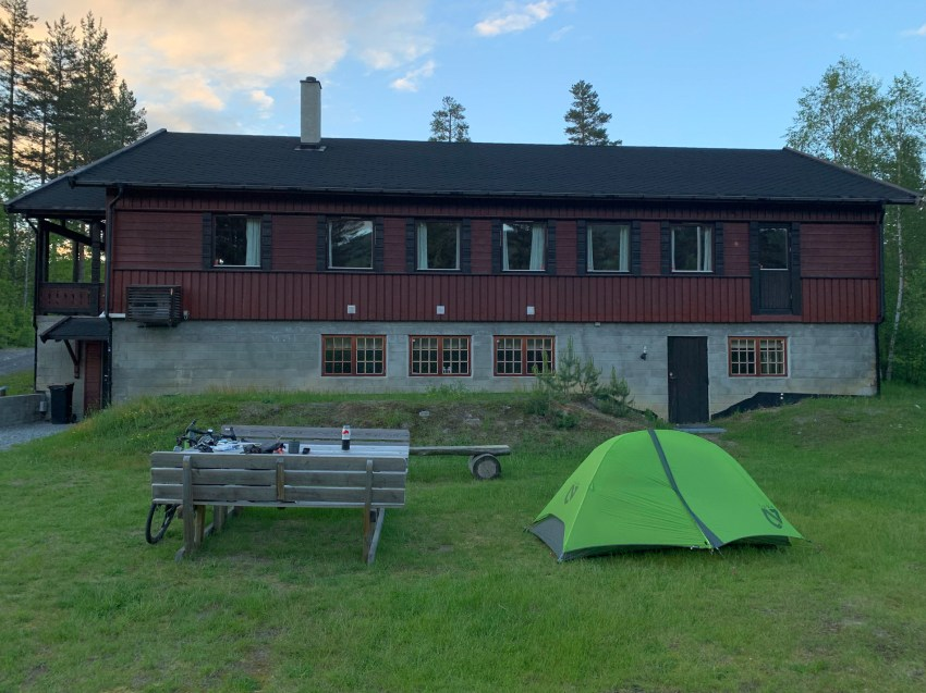 Camping next to the community building of a nearby town