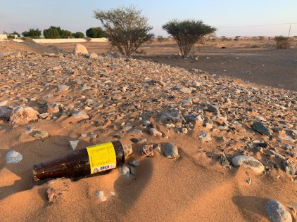 Patches of trash strewn across the desert landscape were, unfortunately, too common of a sight
