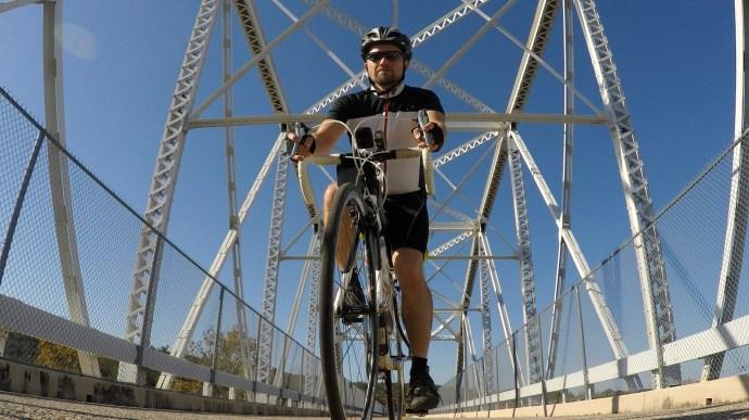 Cycling across a pedestrian/cyclist-only bridge across the Colorado River on day 3.