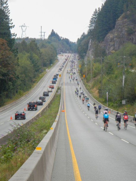 cyclists on highway going uphill