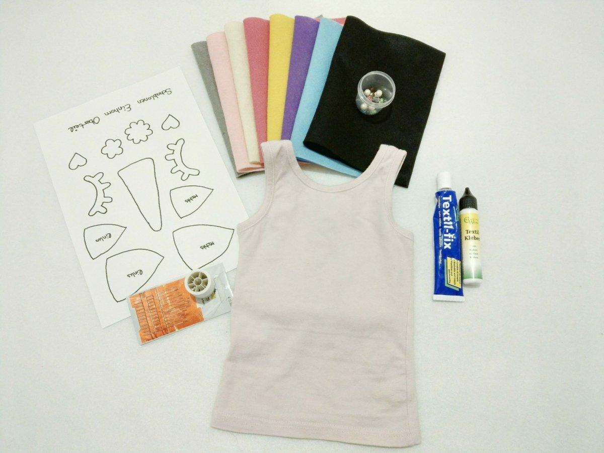 Was man für das Einhorn Kostüm Oberteil benötigt: Filz in verschiedenen Farben, Textilkleber, Schablonen und Perlen