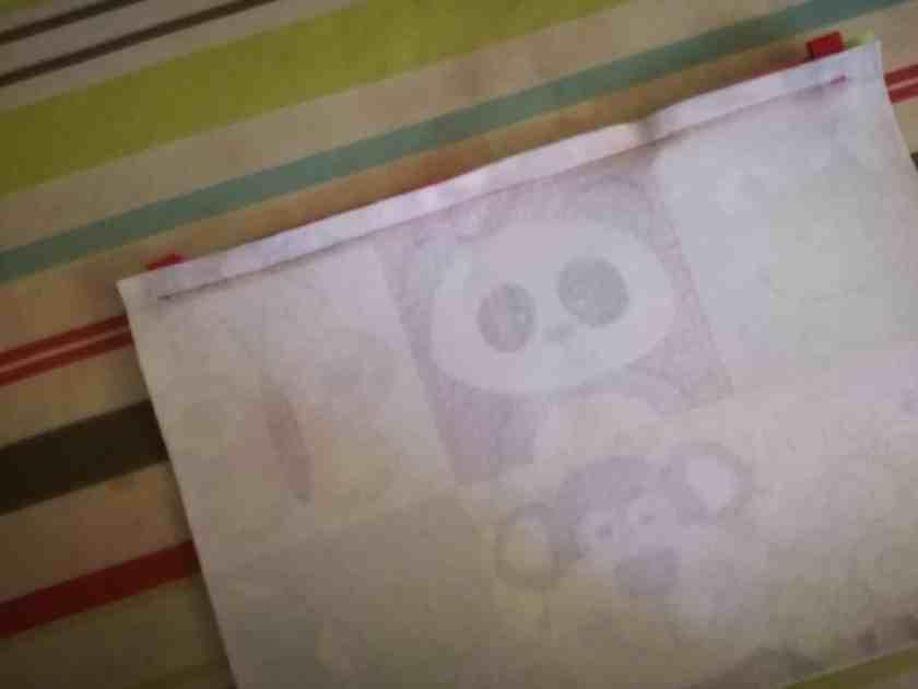 Couture de la fermeture éclair de la trousse panda