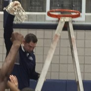 Coach Covault holding his second district championship net.