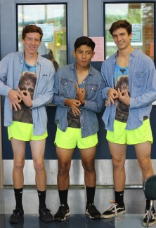 """THURSDAY: Juniors JT Mitchell, Sebastian Rodriguez, and Nick Srodes wear matching neon running shorts with Chewbacca shirts, and jean shirts. They call themselves 'Pibb Boi's' and """"it is really cold,"""" said Srodes. Photo Credit / Hannah Pittman"""