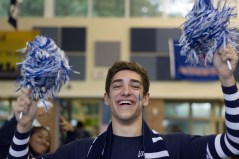 """FRIDAY: Senior Vaughn Taylor shows his school spirit with blue and white pom poms. """"I'm pumped for my last homecoming pep rally,"""" said Taylor. Photo Credit / Hannah Pittman"""