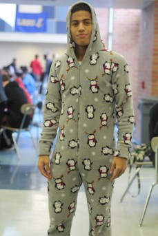 """Senior Cameron Flowers cozies up for pajama day, Thursday's spirit week theme. """"I like penguins so much because they are kinda like me, half black and half white, sometimes walk funny and love seafood,"""" said Flowers. Photo Credit / Michaela Whalen"""